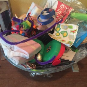 Bowl filled with random toys and kid items