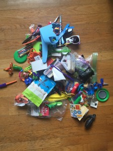 Pile of random toys on wooden floor