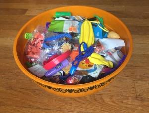Halloween orange bowl with bat trim full of non edible treats