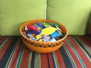 Halloween bowl filled with treats including candy and small toys
