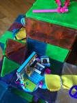 Magna-Tiles magnetic building blocks with Legos and pipe cleaner and felt cloth additions