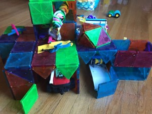 Magna-Tile garage creation with vehicles parked inside structure