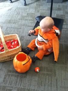 Toddler wearing oversized Nemo clownfish costume