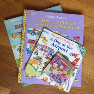 Richard Scarry books in a stack including Cars and Truck and Things That Go, Hop Aboard, A Day at the Airport, and A Busy Day in Busytown