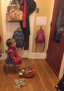 Child waiting at door to hand out Halloween candy