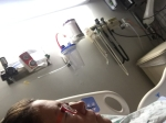 Patient in hospital bed face profile