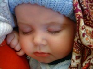 Baby sleeping in ring sling