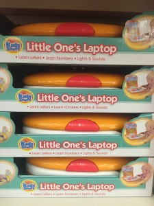 Stack of My first laptop toys on store shelf