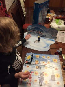 Child opening door on Playmobil NHL advent calendar 2016