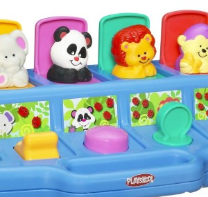 Close up of levers on Playskool Poppin Pals pop up infant and toddler toy