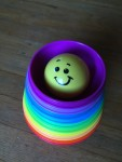 Fisher Price Stack and Roll cups nested together with ball in top smallest purple bowl