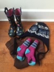 Rain boots, fleece pants, smartwool socks, and winter hat 4T for kids at beach in cold temperatures