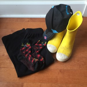 Black fleece pants, farm to feet socks, baseball cap, and Crocs rain boots in yellow for kids