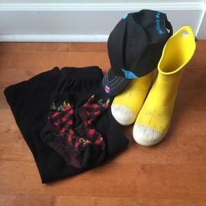 Black fleece pants, farm to feet socks, baseball cap, and Crocs rain boots in yellow for kids