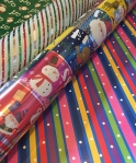 Costco rolls of reversible Christmas and all occasion wrapping paper