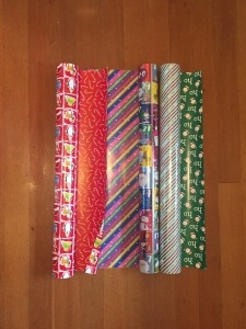 Costco three giant rolls of reversible wrapping paper on rolls