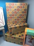 Uncle Goose Classic ABC blocks displayed in store on shelf in Ukranian, Vietnamese, and English