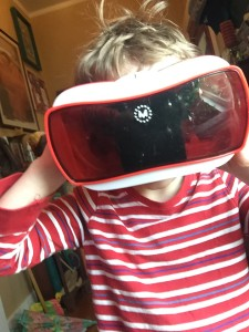 Kids looking in a View-Master virtual reality viewer