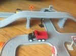 Driven Pocket Series trucks vehicles toy Construction bridges set assembled on wood floor