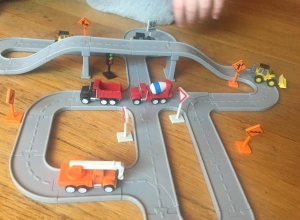 Driven Pocket Series construction bridge set with trucks vehicles and signs and child's hand