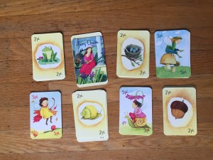 Fairy queen card game eeBoo stacks of cards on wooden floor illustrations