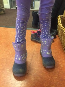 Child legs in pants and matching snow boots
