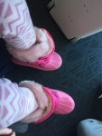 Kids snow boots CG pink Velcro boots with fake pale pink fur trim at top in airport next to Jetkids BedBox