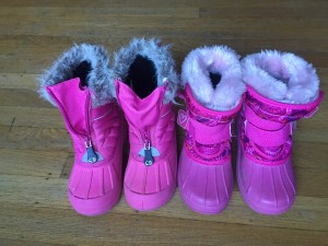 Two pairs of pink kids snow boots lined up on hardwood floor CG Kids and Champion Thermalite with Velcro