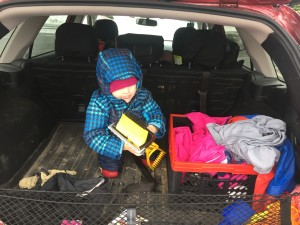 Child in rear back of station wagon in snow clothes from Columbia Frosty Slopes set