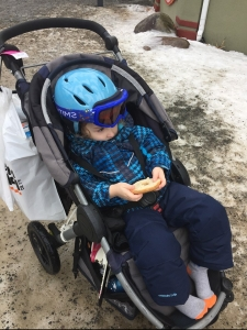 Preschooler wearing Columbia Frosty Slopes snow clothes set while riding in BOB Motion stroller