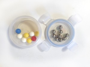 Marbles from different marble runs sorted into Innobaby snack food container sealable easy close lid and bottom
