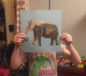 Paint by Stickers elephant page finished held up by girl child