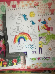 Unicorn magic coloring pages hung up as decorations in child's room