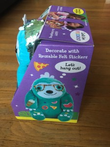 Creativity for Kids weighted pets speedy the sloth in box veiwed from side with reusable stickers attached