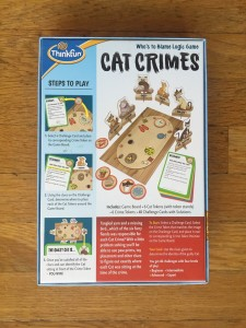 Cat Crimes back of game box showing board layout and characters