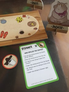 Cat Crimes card challange next to board crime token and cat piece