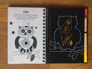 Doodle Mania scratch art notebook page with owl partially scratched off to reveal color underneath