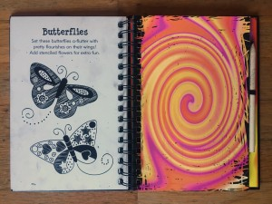 Doodle Mania scratch and sketch spiral notebook butterfly page showing colorful spiral