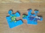 Ceaco Fuzzy Puzzles under the sea theme two pieces on hardwood floor