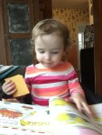 Toddler looking at Cars and Trucks and Things That Go book by Richard Scarry