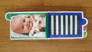 Sassy Look Photo Book album for infants inside with one photo and one empty slot with black and white background
