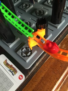 Roller Coaster Challenge logic puzzle STEM game with coaster at end of track and game card showing