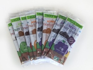Variety of Stretch Island fruit leather flavors fanned out on white counter
