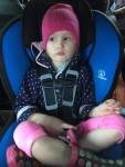 Five year old in rear facing car seat Britax Marathon blue cover