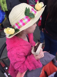 Child riding on stroller board behind Bugaboo Frog stroller in easter hat