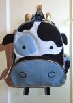 Skip Hop Zoo cow little kids toddler backpack hanging on hook