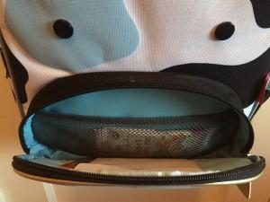 Cow backpack front pocket open with mesh pocket visible inside on Skip Hop cow little kids backpack