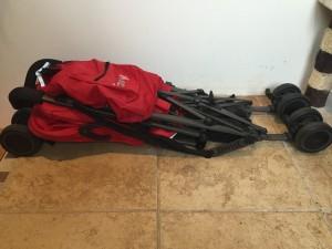Joovy ultralight Groove umbrella stroller in red folded on floor