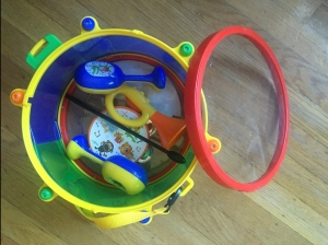 Tots musical drum open with instruments tambourine horn maracas drum stick stored inside