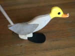 Wooden walking duck push toy on stick with yellow head